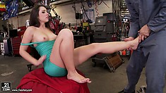 Sexy brunette teases her mechanic's cock with her pretty feet