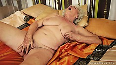 Afternoon delight with plumper granny toying her very bushy bush