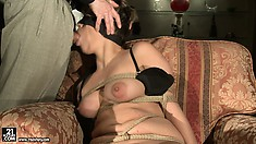 Glorious babe with nice tits is being blind-folded and tempted by angry master