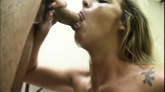 A horny MILF sucks a throbbing cock until it paints her face white
