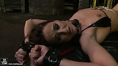 She's toying with her slave and pours hot wax on her, then leaves her