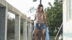 Ravishing Kitar Strang sensually peels off her clothes in the outdoors