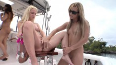 Three striking girls get together on a boat for a wild lesbian party