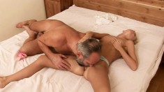 Blonde girl gets into bed with an older stud and gets her twat worked