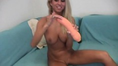 Stacked blonde beauty Clara stretches her narrow pussy on the couch