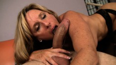 Buxom mom in black stockings Jodi West fucks a young stud's hard dick