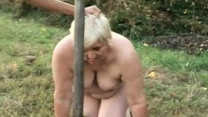 Blonde mature plumper has a masked stud hammering her snatch outside
