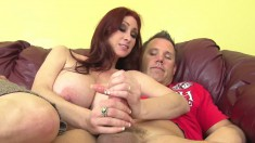 Busty brunette Tipper strokes a thick cock and smothers it between her huge boobs