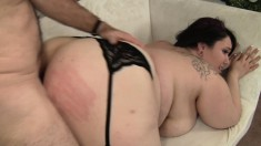 Fat brunette in black stockings finds it hard to resist a long stick