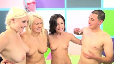 Jennifer, Laela and Jenna take turns blowing and jerking a long stick