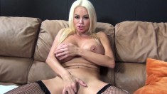Voluptuous blonde milf in stockings Nikita Von James pleases her pussy