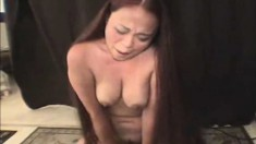 Buxom Oriental Chick Kimmi Rides The Sybian And Screams With Pleasure