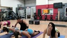 Athletic young sluts share the personal trainer's hard cock in the gym