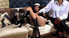 Naughty brunette maid lies on the couch ready to have her desires and needs fulfilled