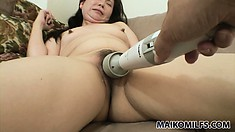 Sophisticated and bonny girl is stimulated by different sex toys