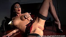 Masturbating sexy brunette is fingering both her pussy and ass