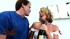Sexy nurse Bella Cole cracks open some champagne with Dr Stone and blows him