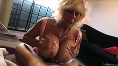 Grandma wakes her boy toy up with a titty fuck and some head