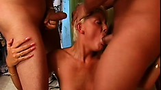 Sexy blond loves the taste of cock and today she gets two of them