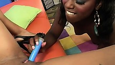 Ebony lesbians delight in the feel and taste of their pussies, and toy fuck