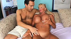 Huge fake tit mature blonde gives head and gets her twat hammered