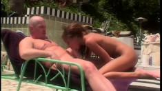 Slender redhead Mya sucks a dick and enjoys hard anal sex by the pool