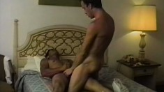 Hot gay stud lies on his belly and his lover fucks his ass from behind