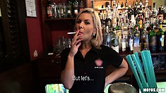 Blonde barmaid closes the bar and takes a break to have a smoke