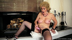 Busty mature lady has a dildo drilling her cunt and a vibrator pleasing her clit