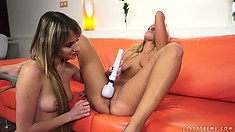 Slut works on her clit with a vibe while her friend fingers her
