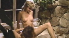Christy Canyon and Ginger Lynn in 80s porn eating some pussy