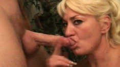Chunky mature woman gets her mouth stuffed with a thick sausage