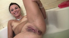 Two beautiful babes indulge in intense lesbian action in the bathtub