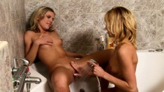 Two delightful blondes play out their lesbian fantasy in the shower