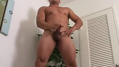 Muscular hunk loves to caress his hard cock all around the house