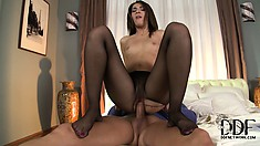 Looking sexy in her black pantyhose, he rips a hole to fuck her