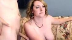 Blonde with perky boobs in black stockings gives blowjob