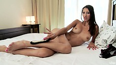 Her nimble fingers prepare her small cunt for a smooth dildo