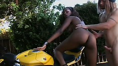 Bending a sexy ebony doll over a motorcycle for some interracial romping