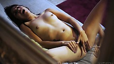 Young amateur babe, with tiny boobs rubbing her pussy in a hot solo video