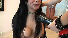Sexy Nadia moans while having her slit worked with a strap-on
