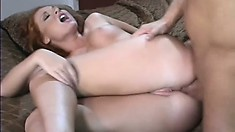 Alluring redhead with perfect big boobs sucks a cock and enjoys rough anal action