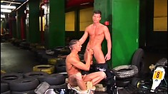 Two cock-hungry young mechanics get naughty while in the shop