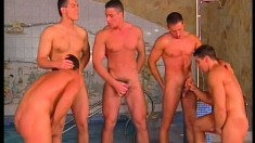 Five handsome young studs having an intense gay orgy by the pool
